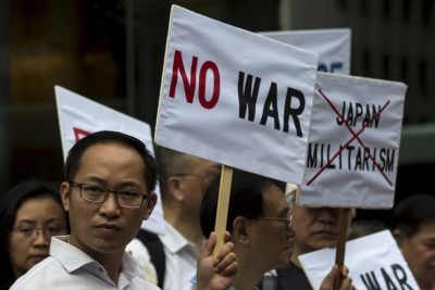 Demonstrators hold anti-Japan placards during a protest outside the Japanese consulate in Hong Kong in August 2015. (Photo: Tyrone Siu/Reuters).