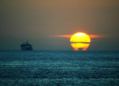 The sun rises during the launch of trilateral coordinated patrols between Indonesia, Malaysia and Singapore in the Strait of Malacca, one of the world's most important shipping lanes on 20 July 2004. (Photo: Reuters/Supri Supri).