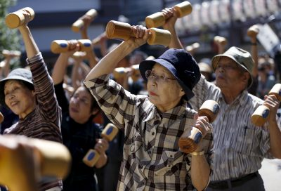 Older people exercise with dumbbells during a health event to mark 'Respect for the Aged Day' at a temple in Tokyo's Sugamo district in September 2015. (Photo: Issei Kato/Reuters).
