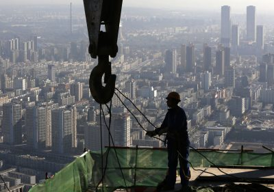 A worker operates at a construction site on the 68th storey of a building in Shenyang, Liaoning province (Photo: Reuters).