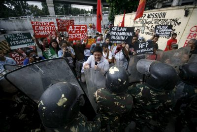 Youth activists hold up placards as they protest against the supposed killing of indigenous people in Mindanao by members of the military, Manila, 4 September, 2015. (Photo: Reuters/Al Falcon).