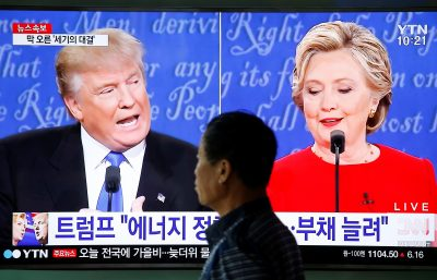 A man walks past a TV broadcast of the first presidential debate between US Democratic presidential candidate Hillary Clinton and Republican presidential nominee Donald Trump, in Seoul, South Korea (Reuters/Kim Hong-Ji).