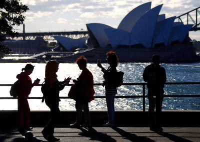 Chinese and Malaysian tourists take photographs of the Sydney Opera House, Sydney Harbour, Australia (Photo: Reuters/David Gray).