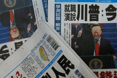 Copies of Taiwanese daily newspaper Liberty Times, with its front page on the inauguration of US President Donald Trump, are seen a printing house in Taipei, Taiwan, 21 January 2017 (Photo: Reuters/Tyrone Siu)