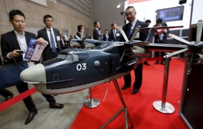 Visitors look at a model of a Japan Maritime Self-Defense Forces US-2 search-and-rescue amphibian plane during a defence exhibition and conference in Yokohama, Japan, 13 May 2015. (Photo: Reuters/Toru Hanai).