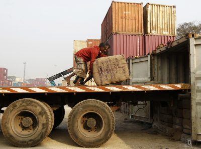 Workmen unload a truck at a port in Kolkata. Major ports cause shippers frustration while smaller, private ports are increasing efficiency and market share. (Photo: Reuters/Rupak De Chowdhuri).