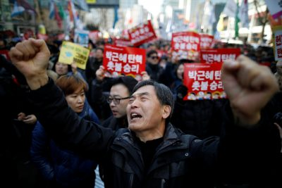 People react after hearing that former president Park Geun-hye's impeachment was accepted in front of the Constitutional Court in Seoul, South Korea, 10 March, 2017 (Photo: Reuters:Kim Hong-Ji).
