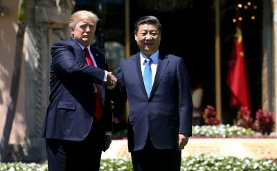 US President Donald Trump (L) and China's President Xi Jinping shake hands while walking at Mar-a-Lago estate after a bilateral meeting in Palm Beach, Florida, 7 April 2017. (Photo: Reuters/Carlos Barria)