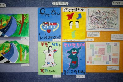 Posters bearing messages wishing unification between the two Koreas hang on a wall at the Daesungdong Elementary School, a school inside the demilitarised zone separating the two Koreas, in Paju, South Korea, 22 November 2016 (Photo: Reuters/Kim Hong-Ji).