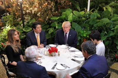 A clear-cut success for Japan's diplomacy: Japanese Prime Minister Shinzo Abe, US President Donald Trump, their wives and guests at Mar-a-lago, Florida, in February 2017. (Photo: Reuters/Carlos Barria).