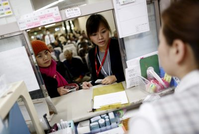 Dang Nguyen Thuc Vien, centre, the daughter of refugees from South Vietnam, interprets for a local Vietnamese resident at a hospital in Kanagawa prefecture, south of Tokyo. What constitutes an 'immigrant' in Japan 'has not been clearly defined'. (Photo: Reuters/Yuya Shino).