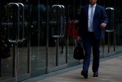 A man walks outside a commercial building at the financial Central district in Hong Kong, China, 23 November 2017 (Photo: Reuters/Yip).
