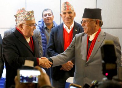 Chairman of Communist Party of Nepal (Unified Marxist–Leninist) (CPN–UML) party Khadga Prasad Sharma Oli, shakes hands with the chairman of Communist Party of Nepal (Maoist Centre) Pushpa Kamal Dahal, also known as Prachanda, during a news conference in Kathmandu, Nepal, 17 December 2017 (Photo: Reuters/Chitraka).
