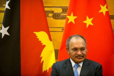 Papua New Guinea's Prime Minister Peter O'Neill watches a signing ceremony at the Great Hall of the People in Beijing, China, 6 July 2016 (Photo: Reuters/Mark Schiefelbein).