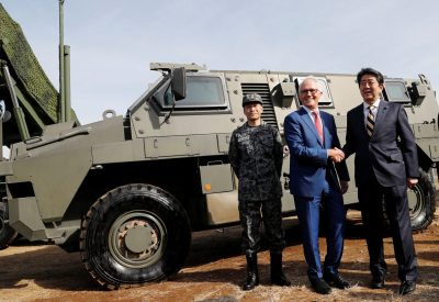 Australian Prime Minister Malcolm Turnbull shakes hands with Japanese Prime Minister Shinzo Abe in front of a Bushmaster military vehicle at Camp Narashino, Japan, 18 January 2018 (Photo: Reuters/Kim Kyung-Hoon).
