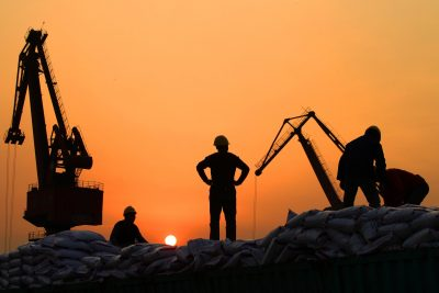 Workers load imported goods at a port in Nantong, Jiangsu province, 24 February 2016 (Photo: Reuters/China Daily).