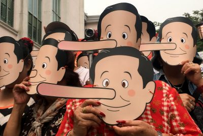 Pro-democracy activists wear masks mocking Thailand's Prime Minister Prayuth Chan-ocha as Pinocchio during a protest against the junta at a university in Bangkok, Thailand on 24 February 2018. (Photo: Reuters/Panarat Thepgumpanat).
