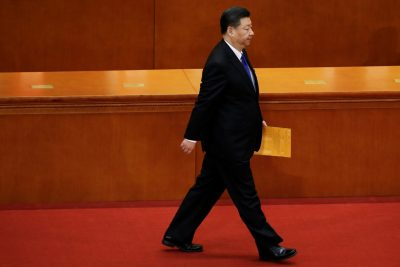 Chinese President Xi Jinping walks with his ballot at the seventh plenary session of the National People's Congress at the Great Hall of the People in Beijing, China, 19 March 2018 (Photo: Reuters/Jason Lee).