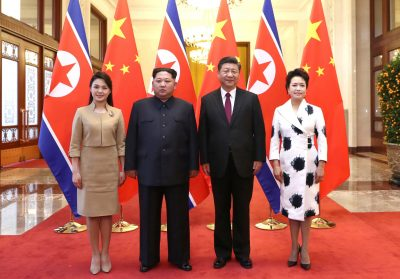 North Korean leader Kim Jong Un and wife Ri Sol Ju pose for a picture with Chinese President Xi Jinping and wife Peng Liyuan at the Great Hall of the People in Beijing, China, 28 March 2018 (Photo: Reuters/Ju Peng/Xinhua).