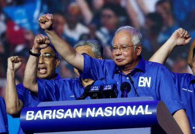 Malaysian Prime Minister and Barisan Nasional President Najib Razak gestures as he speaks during the launch of the Barisan Nasional's manifesto for the upcoming general elections, Kuala Lumpur, Malaysia, 7 April 2018 (Photo: Reuters/Lai Seng Sin).