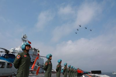 Navy personnel of the Chinese People's Liberation Army (PLA) Navy take part in a military display in the South China Sea on 12 April 2018. (Photo: Reuters/Stringer).