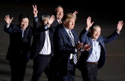 The three Americans formerly held hostage in North Korea gesture next to US President Donald Trump and Secretary of State Mike Pompeo upon their arrival at Joint Base Andrews, Maryland on 10 May 2018. (Photo: Reuters/Jim Bourg).
