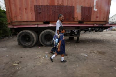 A father walks his child to school near Sekolah Darurat Kartini, Jakarta, Indonesia. (Photo: Reuters/Beawiharta).