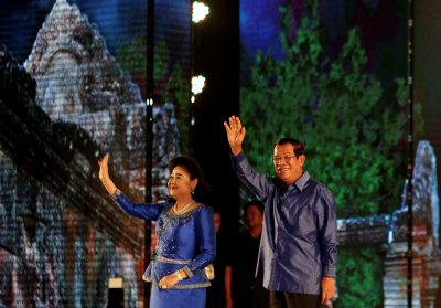 Cambodia's Prime Minister Hun Sen and his wife Bun Rany greet people during a commemorating the 10th anniversary of Preah Vihear temple and the first anniversary of Sambo Prei Kuk temple's being listed as a UNESCO World Heritage Site, Phnom Penh, Cambodia, 15 July 2018 (Photo: Reuters/Samrang Pring).