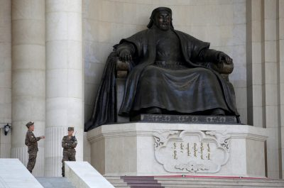 Security personnel chat next to the statue of Genghis Khan at the parliament buildingin Ulaanbaatar, Mongolia, 27 June 2016 (Photo: Reuters/Jason Lee).
