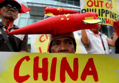 Protestors display placards during a rally by leftwing activists outside the Chinese Consulate to protest Beijing's continued reclamation activities in the South China Sea, Makati, Metro Manila, Philippines, 10 February 2018 (Photo: Reuters/Erik De Castro).