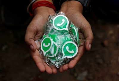 A WhatsApp-Reliance Jio representative displays key chains with the logo of WhatsApp for distribution during a drive by the two companies to educate users, on the outskirts of Kolkata, India, 9 October 2018 (Photo: Reuters/Rupak De Chowdhuri).