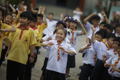 Students exercise at a school in Bangkok, Thailand. (Photo: Reuters/Athit Perawongmetha).