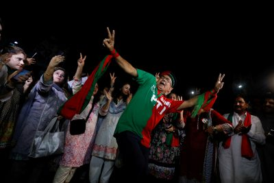 Supporters of Imran Khan, chairman of the Pakistan Tehreek-e-Insaf (PTI) party, celebrate a day after the general election in Peshawar, Pakistan, 26 July 2018 (Photo: Reuters/Fayaz Aziz).