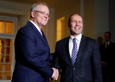 The new Australian Prime Minister Scott Morrison shakes hands with the new Treasurer Josh Frydenberg after the swearing-in ceremony in Canberra, Australia, 24 August 2018 (Photo: Reuters/David Gray).
