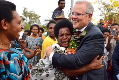 Australia's Prime Minister Scott Morrison is hugged by a woman as he greets locals at the opening of a new building at the University of Papua New Guinea after the Asia Pacific Economic Cooperation forum in Port Moresby, Papua New Guinea, 18 November 2018 (Reuters/Mick Tsikas).