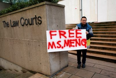 A man holds a sign outside of the BC Supreme Court bail hearing of Huawei CFO Meng Wanzhou, who is being held on an extradition warrant in Vancouver, British Columbia, Canada, 10 December 2018 (Photo: Reuters/David Ryder).