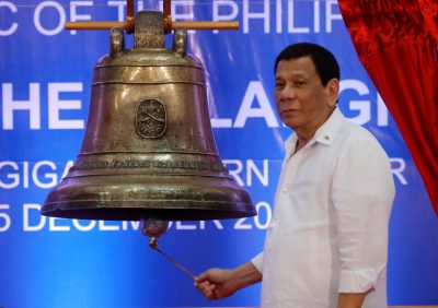 President Rodrigo Duterte rings a Balangiga bell during a ceremony marking the return of three Balangiga bells taken by the US military as war booty 117 years ago, at Balangiga, Eastern Samar in central Philippines 15 December 2018 (Photo: Reuters/Erik De Castro).