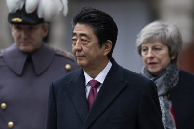 Britain's Prime Minister Theresa May walks with Japanese Prime Minister Shinzo Abe as he receives a military Guard of Honour at the Foreign and Commonwealth Office ahead of bilateral talks in London, Britain, 10 January 2019 (Photo: Reuters/Dan Kitwood).