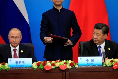 China's President Xi Jinping and Russia's President Vladimir Putin attend a signing ceremony during the Shanghai Cooperation Organization summit in Qingdao, Shandong Province, China, 10 June 2018 (Photo: Reuters/Aly Song).