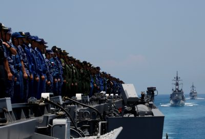 Sailors on Japanese helicopter carrier Kaga wait as Japanese destroyers Inazuma and Suzutsuki approach during a joint naval drill in the Indian Ocean, Indonesia, 22 September 2018 (Reuters/Kim Kyung-hoon).