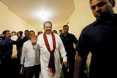 Mahinda Rajapaksa waves as he arrives at the parliament in Colombo, Sri Lanka on 29 November 2018 after he was newly appointed as Prime Minister (Photo: Reuters/Dinuka Liyanawatte).