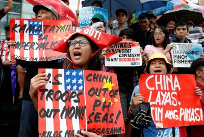 Activists display placards as they chant slogans during a rally to protest alleged harassment of Philippine fishermen at the Scarborough Shoal in the disputed South China Sea, Makati, Metro Manila, Philippines, 12 June 2018 (Photo: Reuters/Erik De Castro).