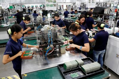 Filipino employees work at the assembly line of Kinpo Electronics factory in Malvar, Batangas, Philippines, 10 August 2018 (Photo: Reuters/Erik De Castro).