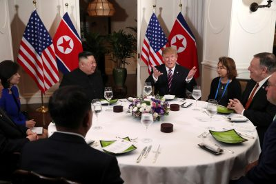 U.S. President Donald Trump and North Korean leader Kim Jong Un sit down for a dinner during the second U.S.-North Korea summit at the Metropole Hotel in Hanoi, Vietnam, 27 February 2019 (Photo: Reuters/Leah Millis).