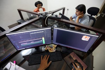 "Staff members of the fact checking website, ""Alt News"", check photos and videos posted on social media platforms inside their office in Ahmedabad, India, 1 March 2019 (Photo: Reuters/ Amit Dave)."