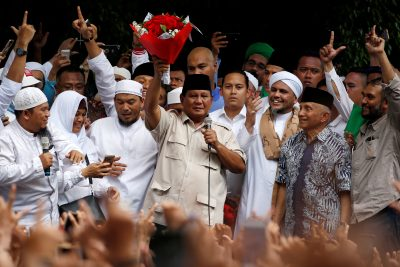 Indonesia's presidential candidate Prabowo Subianto holds flowers from a supporter, as he gives a speech after this week's presidential election in Jakarta, Indonesia, 19 April 2019 (Photo: Reuters/Willy Kurniawan).