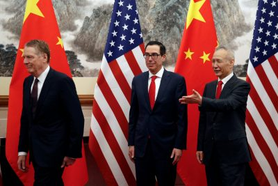 Chinese Vice Premier Liu He, right, shows the way to US Treasury Secretary Steven Mnuchin, center, and US Trade Representative Robert Lighthizer, left, 1 May 2019. (Photo: Andy Wong/Pool via Reuters).