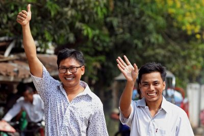Reuters reporters Wa Lone and Kyaw Soe Oo gesture as they walk to Insein prison gate after being freed, after receiving a presidential pardon in Yangon, Myanmar, 7 May 2019. REUTERS/Ann Wang