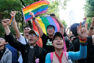 Same-sex marriage supporters celebrate after Taiwan became the first place in Asia to legalise same-sex marriage, outside the Legislative Yuan in Taipei, Taiwan, 17 May 2019 (Photo: Reuters/Tyrone Siu).