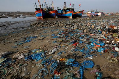 Fishermens' boats are seen at a beach covered with plastic waste in Thanh Hoa province, Vietnam, 4 June 2018 (Photo: Reuters/Kham).